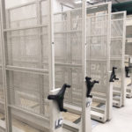 mobile shelving system, metal racking for art museum, paintings and prints, black handles