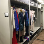 historical costume storage on grey mobile shelving system