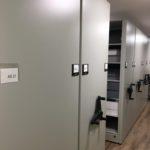 grey mobile shelving black handles easy movement art history storage