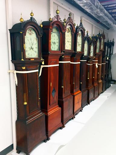 dark wood vintage and historic clocks on art rack