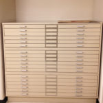 stacked white flat file cabinets view finder