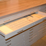 medium wood laminate top and side panel flat file cabinet for museum